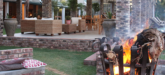 Front terrace with blazing fire